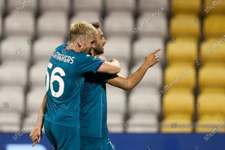 Milan's Hakan Calhanoglu, right, celebrates with his teammate Alexis Saelemaekers after he scored his side's second goal during an Europa League second qualifying round soccer match between Shamrock Rovers and AC Milan at the Tallaght Stadium in Dublin, in Dublin