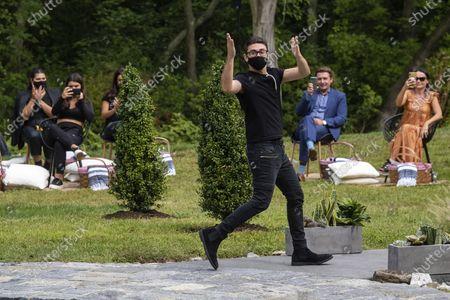 Designer Christian Siriano walks the runway following his show during New York Fashion Week, in Westport, Conn