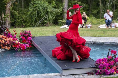 Stock Photo of Pregnant model Coco Rocha walks the runway during the Christian Siriano fashion show held at Christian's home as part of New York Fashion Week, in Westport, Conn