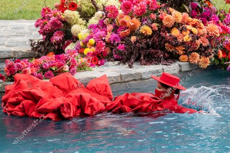 Pregnant model Coco Rocha swims in a pool during the Christian Siriano fashion show held at Christian's home as part of New York Fashion Week, in Westport, Conn