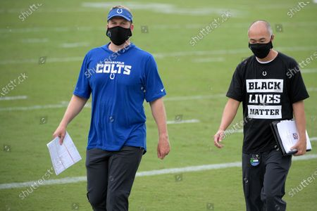 Stock Picture of Indianapolis Colts offensive quality control coach Parks Frazier, left, and senior football strategy analyst George Li walk off the field after an NFL football game against the Jacksonville Jaguars, in Jacksonville, Fla