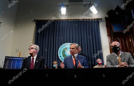 Stock Picture of Lt. Governor Dan Patrick, left, Texas Gov. Greg Abbott, and Speaker Dennis Bonnen, right, attend a news conference where they provided an update to Texas' response to COVID-19, in Austin, Texas