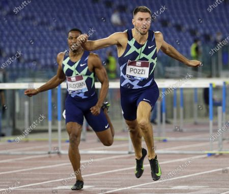 Great Britain's Andrew Pozzi, right, in front of France's Willhelm Belgian, wins in 13.15 seconds the men's 110m hurdles competition at the Golden Gala Pietro Mennea IAAF Diamond League athletics meet in Rome