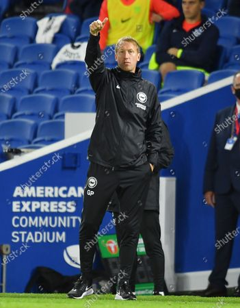 Brighton's head coach Graham Potter gives instructions during the English League Cup soccer match between Brighton and Portsmouth at Amex arena in Brighton, England