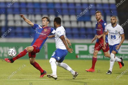 Osijek's Talys, center right, fights for the ball with Basel's Valentin Stocker, right, during the Europa League second qualifying round soccer match between Osijek and Basel at the Gradski Vrt stadium in Osijek, Croatia