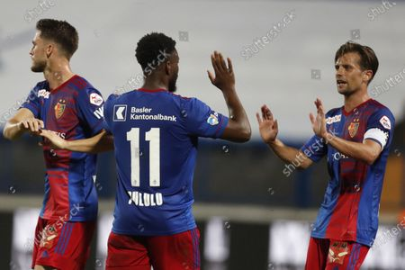 Basel's Valentin Stocker, right, celebrates with his teammate Afimico Pululu, his goal against Osijek during the Europa League second qualifying round soccer match between Osijek and Basel at the Gradski Vrt stadium in Osijek, Croatia