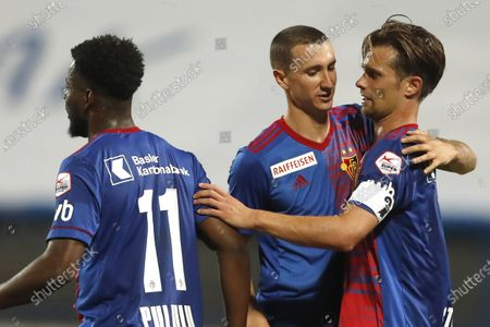 Basel's Valentin Stocker, right, celebrates with his teammate his goal against Osijek during the Europa League second qualifying round soccer match between Osijek and Basel at the Gradski Vrt stadium in Osijek, Croatia