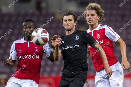 Servette's player Miroslav Stevanovic, center, fights for the ball with two Reims player Ghislain Konan, left, and Wout Faes, right, during the UEFA Europa League second round qualifying between Switzerland's Servette FC and French's Stade de Reims, at the Stade de Geneve stadium, in Geneva, Switzerland, Thursday, September 17, 2020.