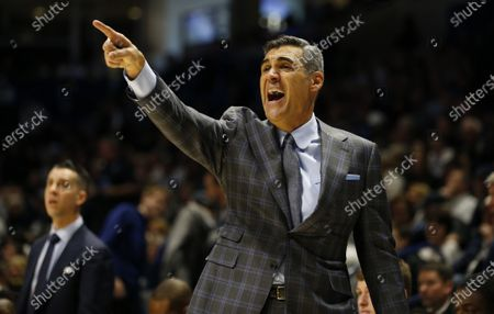 Villanova head coach Jay Wright directs his team during the second half of an NCAA college basketball game against Xavier in Cincinnati. The Division I Council voted, to start the NCAA men's and women's basketball season Nov. 25, the day before Thanksgiving