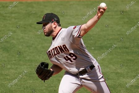Arizona Diamondbacks starting pitcher Alex Young throws to the Los Angeles Angels during the first inning of a baseball game, in Anaheim, Calif