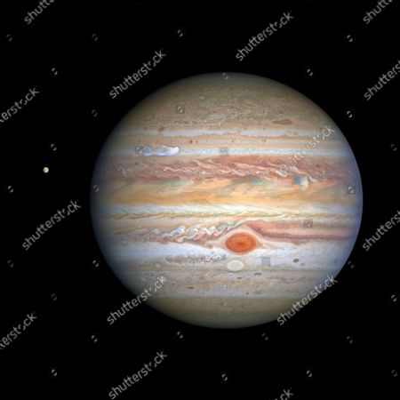 This Aug 25, 2020 image captured by NASA's Hubble Space Telescope shows the planet Jupiter and one of its moons, Europa, at left, when the planet was 406 million miles from Earth. The new photo was released by the Space Telescope Science Institute in Baltimore on