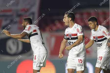 Stock Image of Hernanes of Brazil's Sao Paulo, center, and teammates Reinaldo, left, and Gabriel Sara celebrate after Enzo Perez of Argentina's River Plate scored an own goal during a Copa Libertadores Group D soccer match at the Morumbi stadium in Sao Paulo, Brazil