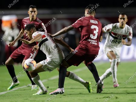 Stock Picture of Fabricio Angileri of Argentina's River Plate pushes Hernanes of Brazil's Sao Paulo during a Copa Libertadores Group D soccer match at the Morumbi stadium in Sao Paulo, Brazil