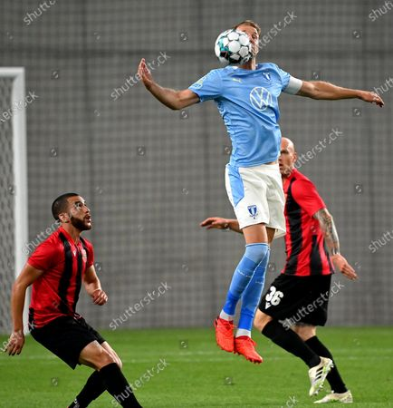 Stock Picture of Mohamed Mezgrani (L) and Botond Barath of Budapest Honved (R) vie for the ball with Ola Toivonen of Malmo (C) during the soccer Europe League qualifying second round match Budapest Honved vs. Malmo in the Hidegkuti Nandor Stadium in Budapest, Hungary, 17 September 2020.