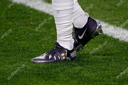 Detail of the Nike cleats honoring Chadwick Boseman worn by Cleveland Browns wide receiver Jarvis Landry (80) during an NFL football game against the Cincinnati Bengals, in Cleveland