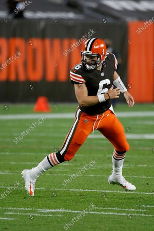 Cleveland Browns quarterback Baker Mayfield (6) rolls out after handing off the ball during an NFL football game against the Cincinnati Bengals, in Cleveland