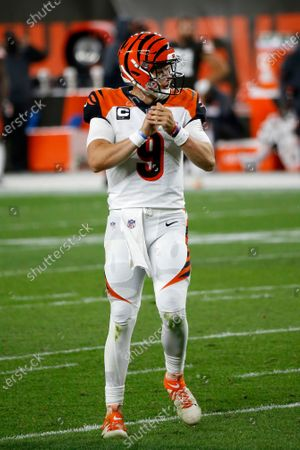 Cincinnati Bengals quarterback Joe Burrow (9) rolls out after handing off the ball during an NFL football game against the Cleveland Browns, in Cleveland
