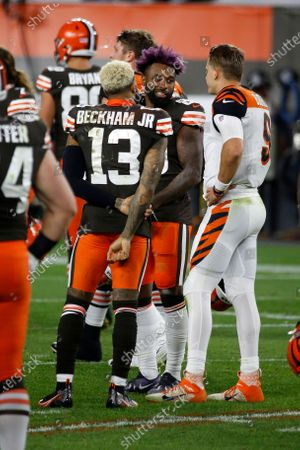 Cincinnati Bengals quarterback Joe Burrow (9) talks with Cleveland Browns wide receiver Odell Beckham Jr. (13) and wide receiver Jarvis Landry (80) after an NFL football game, in Cleveland