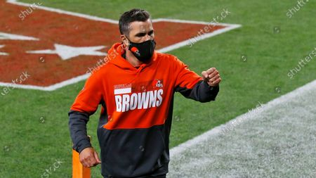 Stock Photo of Cleveland Browns coach Kevin Stefanski pumps his fist as he runs off the field after the Browns defeated the Cincinnati Bengals 35-30 in an NFL football game, in Cleveland