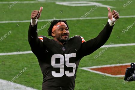 Cleveland Browns defensive end Myles Garrett celebrates after the Browns defeated the Cincinnati Bengals 35-30 in an NFL football game, in Cleveland