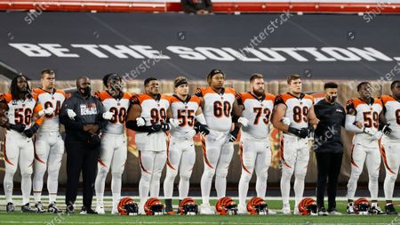 The Cincinnati Bengals line up arm-in arm before an NFL football game against the Cleveland Browns, in Cleveland