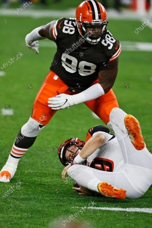 Cleveland Browns defensive tackle Sheldon Richardson (98) sacks Cincinnati Bengals quarterback Joe Burrow during the first half of an NFL football game, in Cleveland