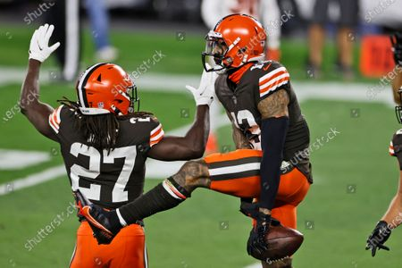 Cleveland Browns wide receiver Odell Beckham Jr., right, celebrates with running back Kareem Hunt after Beckham's touchdown during the first half of the team's NFL football game against the Cincinnati Bengals, in Cleveland