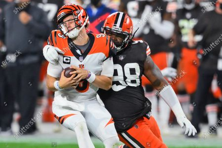 Cleveland Browns defensive tackle Sheldon Richardson (98) sacks Cincinnati Bengals quarterback Joe Burrow (9) during the first half of an NFL football game, in Cleveland