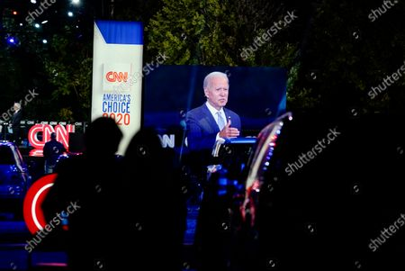 Democratic presidential candidate former Vice President Joe Biden ]is seen on a video screen as he participates in a CNN town hall moderated by Anderson Cooper in Moosic, Pa