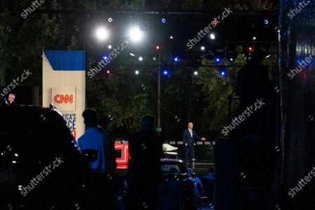 Audience members watch from their cars as Democratic presidential candidate former Vice President Joe Biden speaks during a CNN town hall moderated by Anderson Cooper in Moosic, Pa