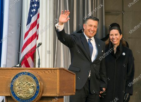 Governor Brian Sandoval, with wife Lauralyn McCarthy, gives one last wave as governor before Governor-elect Steve Sisolak is sworn into office on the steps of the Nevada State Capitol in Carson City, Nev. Former Gov. Sandoval has been named president of the University of Nevada, Reno. University regents voted to hire the former two-term Republican governor, U.S. District Court judge and MGM Resorts International executive to begin Oct. 5, 2020, with a four-year contract