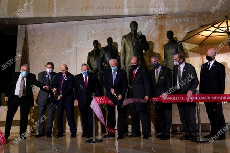 Members of the Eisenhower Memorial Commission cut a ribbon at the Eisenhower Memorial dedication ceremony in Washington, . Designed by world-renowned architect Frank Gehry, the memorial honors Eisenhower, the young man from Abilene, Kansas who went on to West Point and became a General, a U.S. President and one of the most notable and successful leaders of the last century