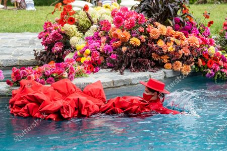 Stock Picture of Model Coco Rocha swims in a pool during the Christian Siriano fashion show held at Christian's home as part of New York Fashion Week on in Westport, Conn