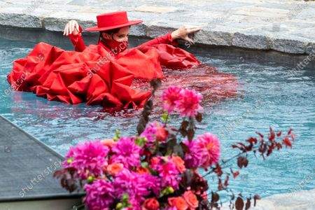 Stock Image of Model Coco Rocha swims in a pool during the Christian Siriano fashion show held at Christian's home as part of New York Fashion Week on in Westport, Conn