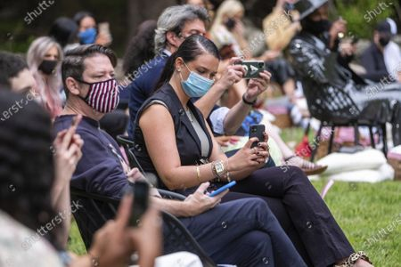 Masked attendees watch the Christian Siriano fashion show held at Christian's home as part of New York Fashion Week on in Westport, Conn