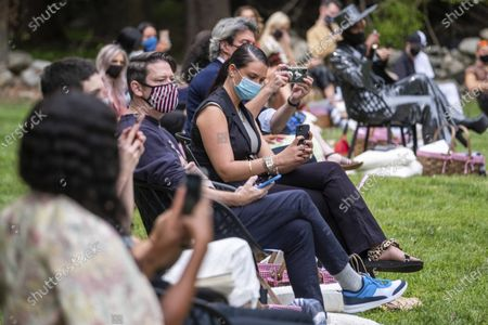 Stock Photo of Masked attendees watch the Christian Siriano fashion show held at Christian's home as part of New York Fashion Week on in Westport, Conn