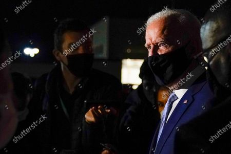 Democratic presidential candidate former Vice President Joe Biden talks with reporters at Wilkes-Barre Scranton International Airport, in Avoca, Pa., after a CNN town hall