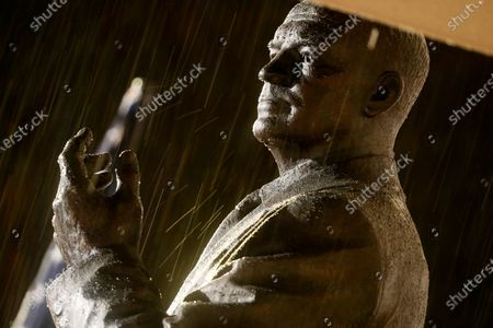 Rain falls upon a statue of Dwight D Eisenhower at the opening of the Dwight D Eisenhower Memorial, honoring the legacy of the World War II Supreme Allied Commander and nation's 34th President