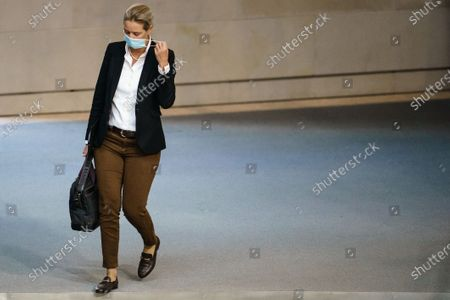 Alternative for Germany party (AfD) faction co-chairwoman in the German parliament Bundestag and deputy chairwoman Alice Weidel takes off her face mask as she arrives for a session at the German parliament 'Bundestag' in Berlin, Germany, 18 September 2020. The future of hospitals is one topic amongst others at the German parliament on 18 September 2020.