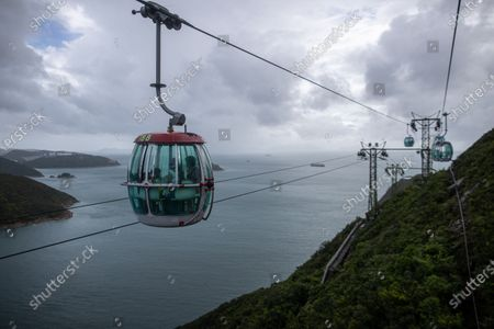 Stock Photo of Visitors ride a cable car at Ocean Park in Hong Kong, China, 18 September 2020. Ocean Park reopened after months of closure due to the coronavirus outbreak. The park is allowed to admit visitors at only 50 percent of its capacity.