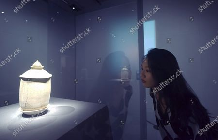 "Visitors watch ""Jade Garment in Gold"", a national treasure of the Western Han Dynasty, at hangzhou Arts and Crafts Museum in Hangzhou, East China's Zhejiang Province, Sept. 12, 2020.