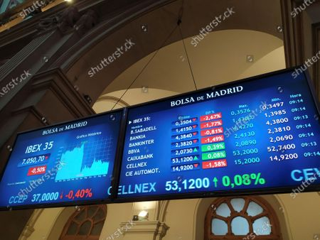 Screens inside the Stock Exchange of Madrid, Spain, 18 September 2020. Spain's IBEX35 index dropped 0,23 percent at the trade opening after Caixabank and Bankia announced their merger to create the biggest bank in the country with assets of 650 billion euros.