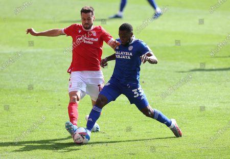 Nottingham Forest's Carl Jenkinson battles with Cardiff City's Junior Hoilett