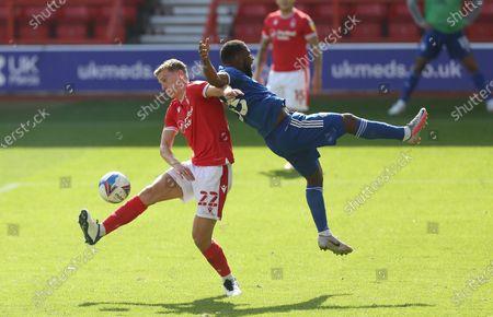Nottingham Forest's Ryan Yates battles with Cardiff City's Junior Hoilett