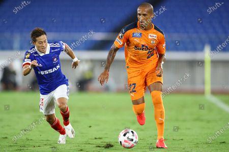 Renato Augusto (22) of Shimizu S-Pulse and Teruhito Nakagawa of Yokohama F. Marinos during the J.League J1 soccer match between Yokohama F. Marinos 3-0 Shimizu S-Pulse at Nissan Stadium in Yokohama, Kanagawa, Japan.
