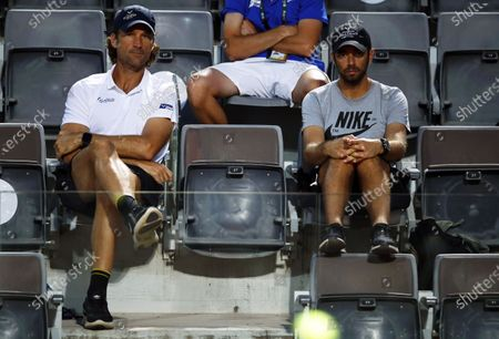Carlos Moya (L), coach of Spain's Rafael Nadal, and Nadal's physio Rafael Maymo (R) follow the men's singles third round match between Nadal and Dusan Lajovic of Serbia at the Italian Open tennis tournament in Rome, Italy, 18 September 2020.
