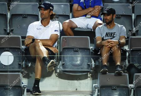 Stock Image of Carlos Moya (L), coach of Spain's Rafael Nadal, and Nadal's physio Rafael Maymo (R) follow the men's singles third round match between Nadal and Dusan Lajovic of Serbia at the Italian Open tennis tournament in Rome, Italy, 18 September 2020.