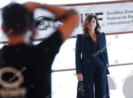 Gina Gershon poses at her arrival to the photocall of the film 'Rifkin's Festival', the latest Woody Allen movie filmed in San Sebastian, as part of the 68th edition of the San Sebastian International Film Festival (SSIFF), in San Sebastian, Spain, 18 September 2020. The film festival will run from 18 to 26 September 2020 under safety measures like obligatory face mask use and red carpets without public due to the Covid-19 coronavirus pandemic. Organizers have also reduced the number of film screenings as well as the seating capacity in cinemas.