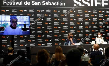 Gina Gershon (C), Spanish actress Elena Anaya (R) and US film director Woody Allen (L, on screen) take part in a press conference during the presentation of the film 'Rifkin's Festival', his latest movie filmed in San Sebastian, as part of the 68th edition of the San Sebastian International Film Festival (SSIFF), in San Sebastian, Spain, 18 September 2020. The film festival will run from 18 to 26 September 2020 under safety measures like obligatory face mask use and red carpets without public due to the Covid-19 coronavirus pandemic. Organizers have also reduced the number of film screenings as well as the seating capacity in cinemas.