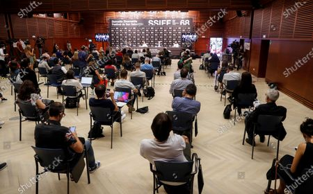 People sitting in social dfistance attend the press conference during the presentation of the film 'Rifkin's Festival', the latest Woody Allen movie filmed in San Sebastian, as part of the 68th edition of the San Sebastian International Film Festival (SSIFF), in San Sebastian, Spain, 18 September 2020. The film festival will run from 18 to 26 September 2020 under safety measures like obligatory face mask use and red carpets without public due to the Covid-19 coronavirus pandemic. Organizers have also reduced the number of film screenings as well as the seating capacity in cinemas.